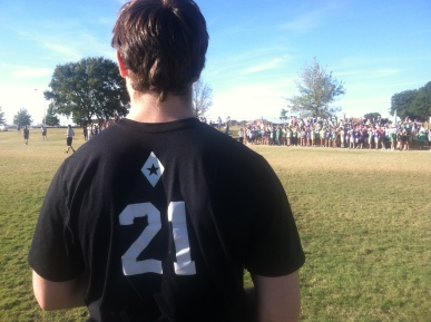 Senior Fiji Shane Rash looks on from the sideline as his teammates play flag football. PHOTO BY COURTNEY BROWN
