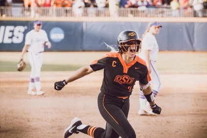 Image Taken At Women's College World Series, Oklahoma State Cowgirls vs Florida Gators Softball Game, Thursday, May 30, 2019, USA Softball Hall of Fame Stadium, Oklahoma City, OK. Courtney Bay/OSU Athletics
