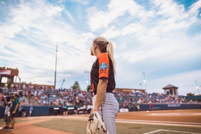 Image Taken At Women's College World Series, Oklahoma State Cowgirls vs Washington Huskies Softball Game, Saturday, June 1, 2019, USA Softball Hall of Fame Stadium, Oklahoma City, OK. Courtney Bay/OSU Athletics